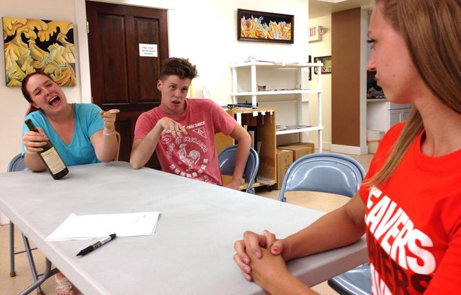 "AFTER SCHOOL Productions' student actors rehearse ""Soap,"" a 15-minute one-act written and directed by Augustus (Gus) Thomas (middle), who plays a disgruntled teenager. On either side of Thomas are Hannah Himshaw (left) as Joy, the ""negligent mother,"" and Courtney Goslin (right) as Wanda, the ""alcoholic grandmother."" The play is described as a ""hilariously bad family sitcom"" appropriate for adults and teens ages 14 and up. Performance times are set for 7:30 p.m. Thursday the 24th through Saturday the 25th. Tickets are $5 and will be available for purchase at The Riverenza, located at 401 East 10th Street, The Dalles."