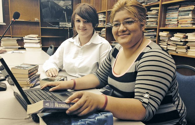 ZARA HERNANDEZ-SANCHEZ, right, and Denise Stillwell are working to bring more books to the Community School Library.