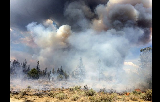 "Moccasin Hill fire burns north of Sprague River and northeast of Klamath Falls, Ore. Lightning struck Oregon more than 6,000 times Sunday and Monday, touching off small fires by the dozens. Such a barrage can be expected to cause numerous ""sleeper"" or holdover fires in coming days."