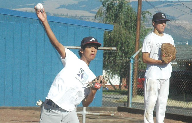 THE DALLES 15U Babe Ruth All Star hurlers Denzel Arellano (left) and Izaac Tapia toss a few warmup pitches. After a tough finish last season, the Stars are looking forward to flipping the switch at the state tournament this week in Ontario. The top two finishes qualify for regionals in two weeks.