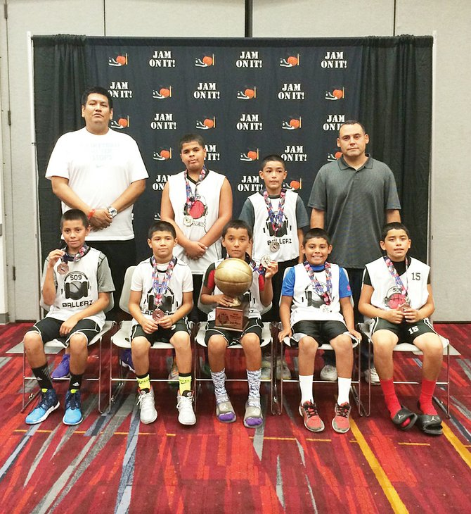 Sunnyside's 509 Ballerz basketball team earned the second-place trophy in the boys fourth grade division at the AAU West Coast National Championships in Las Vegas last weekend. The Sunnyside youngsters compiled a 5-1 record, their only loss coming in the championship game. Team members include (front row L-R) Justice Hart, Devin Escamilla, J.J. Montelongo, Adrian Bazan and Raymond Ramirez; (back row L-R) Coach Germaine Hart, Dhantaye Bennett-Joe, Fenix Medina and Coach Reynaldo Bazan.