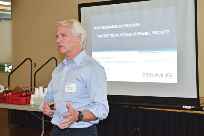Dan Evans of Seattle-based Promus Energy presents to the New Vision board a program to convert cow manure into a renewable natural gas product.