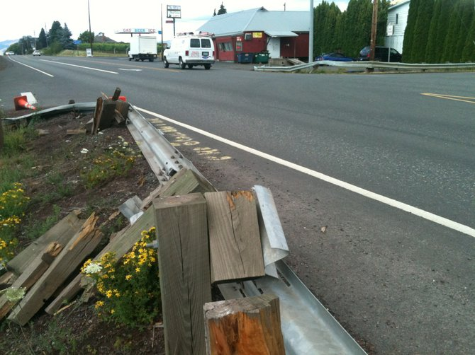 Highway 35 in Pine Grove, looking northeast, damaged guardrails in foreground and background.