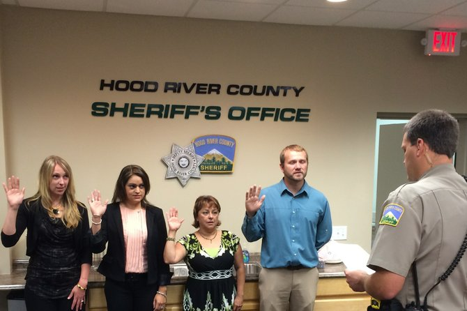 PAROLE and Probation staff take the oath from Sheriff Matt English. From left are Jamie Hepner, Chello Ramirez, Bertha Logsdon, and Shaun Anderson.