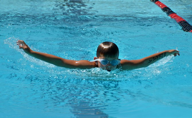 Conner Short, 10, of the Omak Mantarays swim team does the butterfly stroke during the boys age 9-10 100-yard intermediate medley at the county swim championships Saturday.