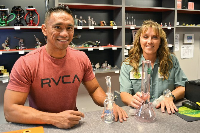 There's more than marijuana available for sale at Altitude, as Manel Valenzuela and Cheryl Wick display a few of the many accessories on hand.