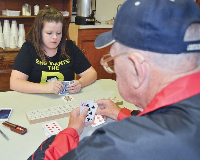 Paul Hatcher of Salem, Ore. eyes his hand while taking on Brittany Pierce of Springfield, Ore. last Friday. The two card players were among the 50-plus cribbage enthusiasts who trekked to the Sunnyside VFW post home for the 2014 Summer Classic, which began last Friday and concluded on Sunday. After the points were added up and the score sheets double-checked, Tim Julkowski of Portland, Ore. was deemed the champion. He bested Todd Malmgren of Clackamas, Ore. Rounding out the top four finishers were Betty Brumley of Sunnyside and Kevin Mansfield of Spokane. Roy Hofbauer of Washougal, Wash. ended up being the top qualifier. In the consolation finals of the annual Summer Classic, Thomas Wilson of Hermiston, Ore. bested Mike Rowe, an Alaskan resident, in the championship match.