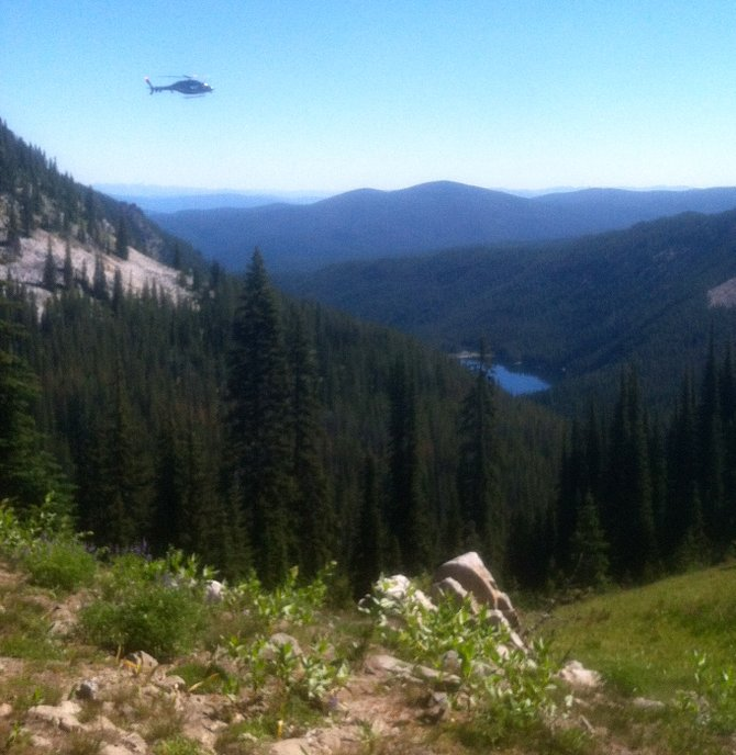 A search and rescue helicopter is pictured peering over Moores Lake during the search for Dr. Jared Pikus of Cottonwood, who was reported missing on Saturday night, July 26, and was found last Sunday afternoon by a search and rescue effort coordinated by the Idaho County Sheriff's Office.