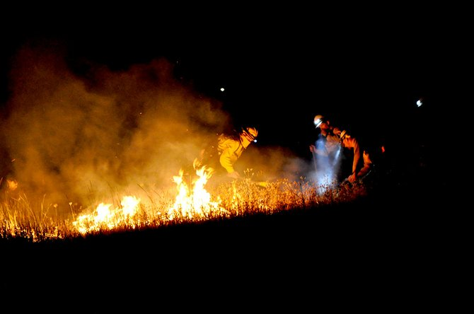 Firefighters work to contain the White Bird Grade fire last Thursday night, July 24, just above U.S. Highway 95.