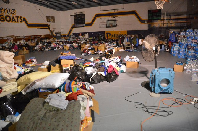 Donations for Carlton Complex wildfire victims have been stacking up at Pateros High School.