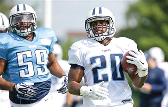 Tennessee Titans running back Bishop Sankey (20) runs the ball during NFL football training camp Tuesday in Nashville, Tenn. Sankey is penciled in to be a running back of consequence for the upcoming fantasy football season that starts in September.