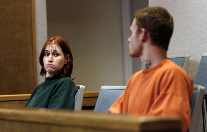 "FILE - In this Oct. 11, 2011 file photo, Holly Grigsby, left, looks at her boyfriend, David ""Joey"" Pedersen, during an appearance in Yuba County Superior Court in Marysville, Calif. On Tuesday, July 15, 2014, a federal judge in Portland, Ore. sentenced Grigsby to life in prison for her role in a Pacific Northwest killing spree that authorities say was part of a white supremacist scheme. Pedersen is scheduled to be sentenced in August 2014."
