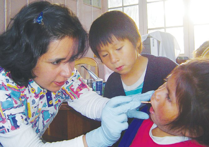 A dental check-up in La Paz, Bolivia is not as routine as in the United States for these orphans. Dr. Ruth Wise traveled to her home country in 2005, 2007 and 2009 to provide dental services for three orphanages, using supplies provided by Spavinaw Dental in Sunnyside.