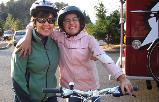 COLLEEN BALLINGER of The Dalles enjoys bicycle riding with her Little Sister as friend and mentor with Big Brothers Big Sisters of the Columbia Gorge. 	Contributed photo