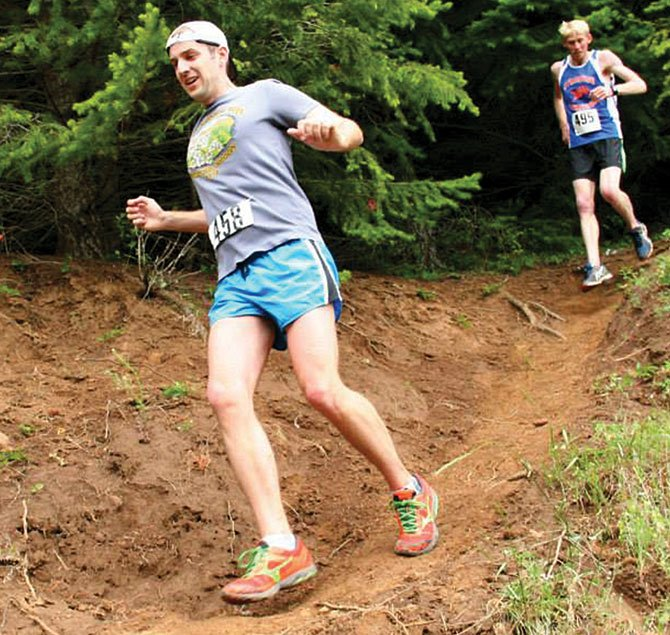 RUNNING ENTHUSIAST Lucas Lembrick carefully hikes down muddy terrain at the Backyard Half Marathon on June 15. On Aug. 10 in Cascade Locks, the inaugural Bridge of the Gods Half Marathon and 10k run takes place. A large crowd of harriers are expected to sign up to take part in the event put together by Breakaway Promotions coordinator Chad Sperry.