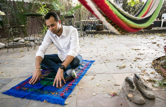 American Muslim Omar Akersim, 26, poses for a photo on his prayer rug  at his home in Los Angeles Friday, Aug. 1. Nearly 40 percent of the estimated 2.75 million Muslims in the U.S. are American-born and the number is growing, with the Muslim population skewing younger than the U.S. population at large, according to a 2011 survey by the Pew Research Center.