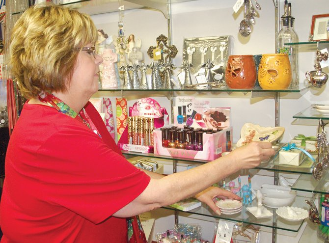 "Arranging gift items that will help others feel better about their stay in the hospital is only a part of Charlene Maling's job as Sunnyside Community Hospital gift shop manager. ""I get to go to market several times a year to purchase items for the shop,"" she said."