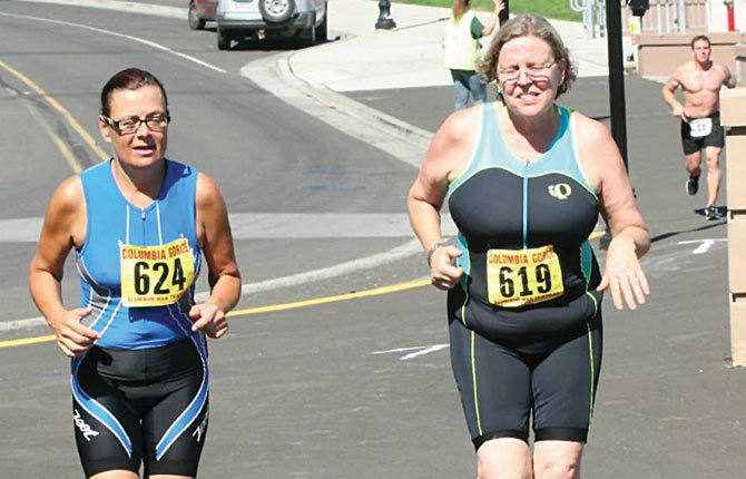 TOP TRIATHLETES Gabrielle McNabb (left) and Dorothy Perkins pound the pavement during the 25th annual Aluminum Run at Riverfront Park in The Dalles. With a crowd of more than 250 expected the North Wasco County Parks and Recreation District has opened up signups for this year's event.
