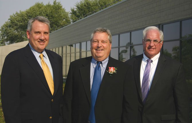 LEADERS OF OREGON Health and Science University and Mid-Columbia Medical Center celebrate their growing affiliation Monday at Fort Dalles Readiness Center. Pictured from left are Dr. Joe Robertson, OHSU president; Duane Francis, MCMC CEO; and Dr. Mark O'Holleran, OHSU director of clinical outreach.