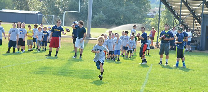 Game time: Hood River Community Education youth football started Monday with the annual Blue and Gold football camp, staffed by HRVHS coaches and players.