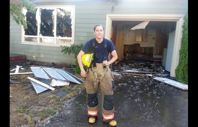 EMT/FIREFIGHTER Michaela Young saw plenty of action in her first two days as a paid member of the Mid-Columbia Fire and Rescue crew. She helped defend The Dalles Country Club from the Rowena Fire Wednesday and was first on the scene to this 1408 Nevada St. house fire early this morning. The vacant house was gutted. Young and the rest of her crew spent quite a few sleepless hours between the two fires.
