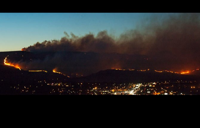 A long line of fire creeps to the west edge of The Dalles approximately 8:30 p.m. Wednesday. Panorama created from two exposures.