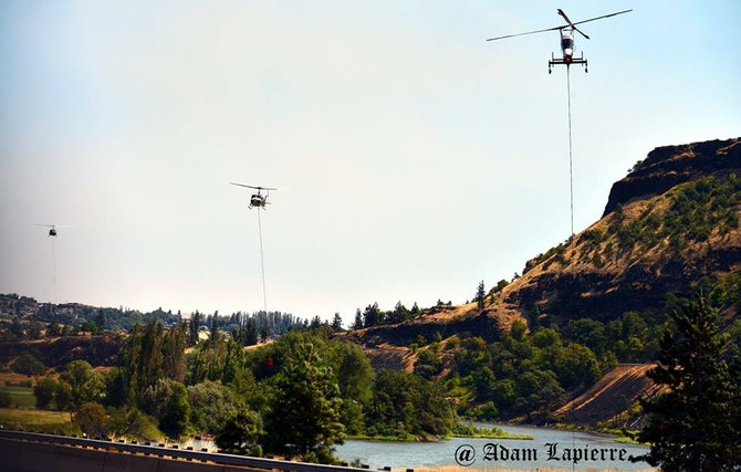 Helicopters refill water buckets during operations on the 2014 Rowena Fire west of The Dalles.