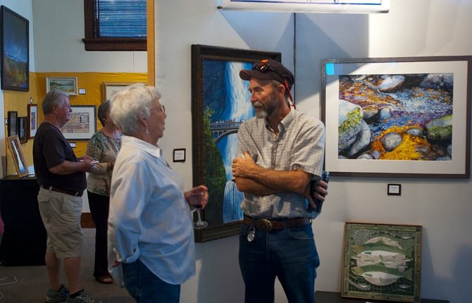 Larry Toll, right, and artist Bonnie Straton chat during the Gorge Artists Create reception at The Dalles Art Center Thursday evening, Aug. 7. Theme of the show is water, and will run through the month of August. Show is sponsored by Rich and Karen Miller and Jim and Nancy Bishop.