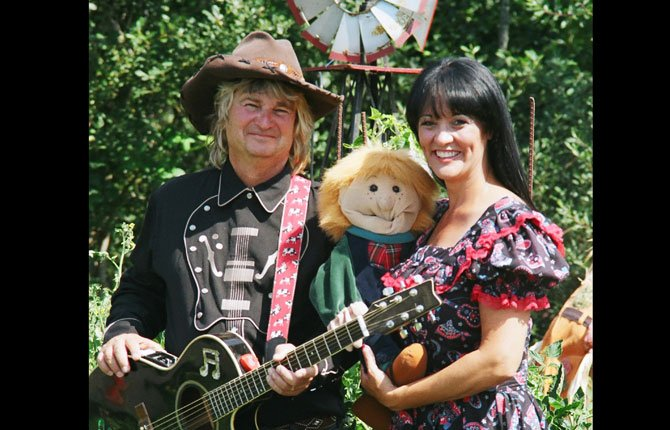 "COWBOY BUCK and Elizabeth will be performing at 11 a.m. on Tuesday, Aug. 12, at The Dalles/Wasco County Public Library.  This show is fun for all ages featuring music, comedy, ventriloquism and a dash of science that fits the summer reading theme: ""FIZZ BOOM READ.""	Contributed photo"