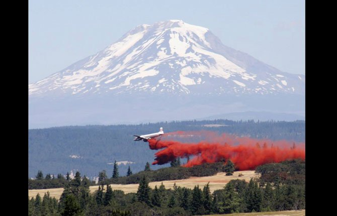 A tanker drops retardant near Tom McCall park as viewed from the top of Mountain View Drive.