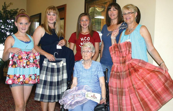 FOUR GENERATIONS of this Wasco County family represent almost eight decades of participation in the Wasco County Fair; picture clockwise from center: Mildred Wagenblast, Emma Koch, Kim Koch, Morgan Brumley, Tonya Brumley and Linda May. The projects they hold represent all four generations.