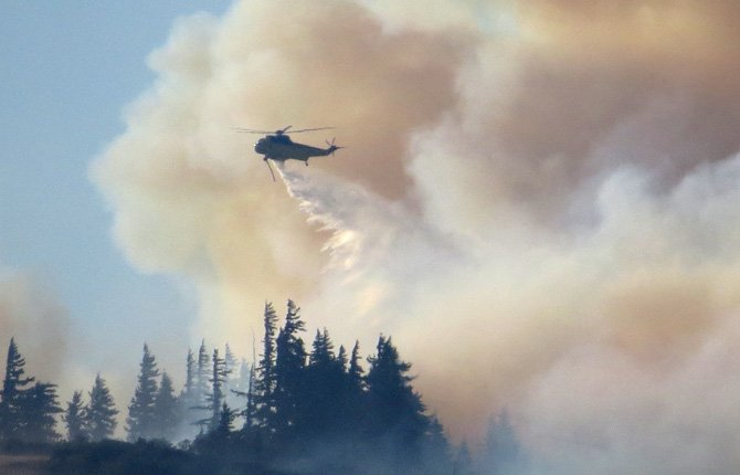 A water helicopter drops its load on the Rowena Fire. Contributed photo/Kiana Pielli