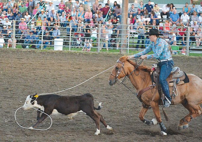 Jillian Geiger of Mt. Vernon gives it her best shot but comes up just short in the breakaway roping competition last Friday.
