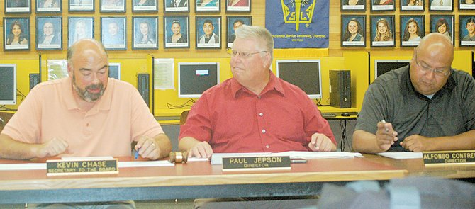 Grandview School District Superintendent Kevin Chase (L) encourages the Grandview School Board to approve a pay increase for substitute teachers during last night's Grandview School Board meeting. Also pictured are Grandview School Board members Paul Jepson and Alfonso Contreras.