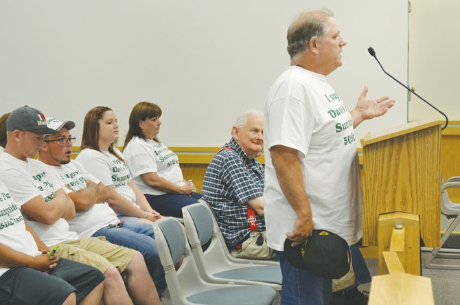 Joined by about a dozen supporters all wearing white shirts backing his efforts, Dave Rand appealed to the Sunnyside City Council last night to not renew a moratorium that bans the sales of recreational marijuana.