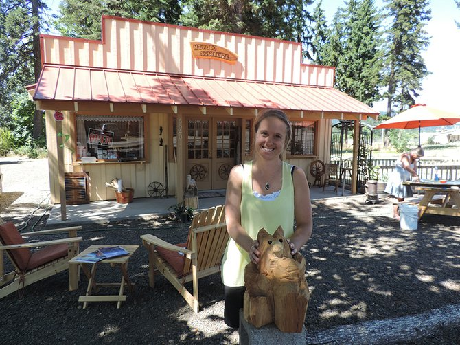 OWNER Janine Ehrentraut relaxes in front of Mt. Hood Socialize, 6540 Cooper Spur Rd., where she sells specialty oils and vinegars, and encourages local residents to contact her about holding workshops at her store.