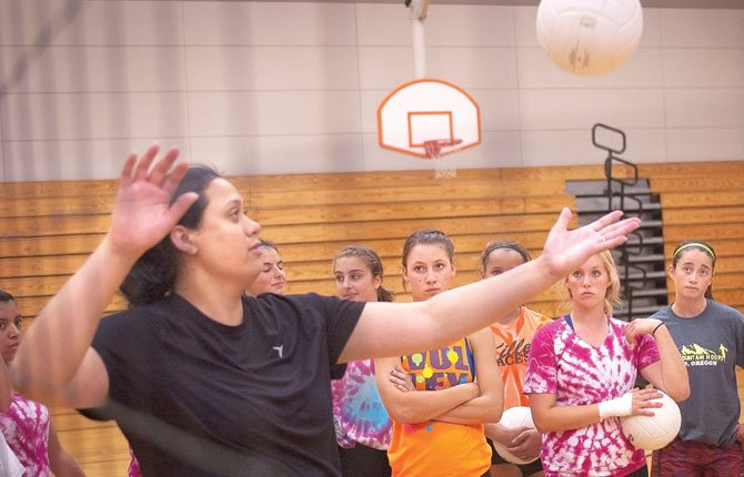A VOLLEYBALL CLINIC includes a demonstration by Neticia Fanene.