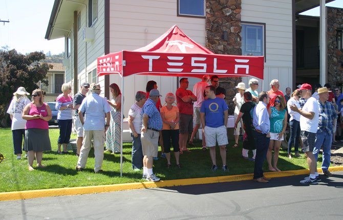 TESLA OWNERS gather at Cousins Country Inn Aug. 9 for the dedication of new supercharging stations for the vehicles.