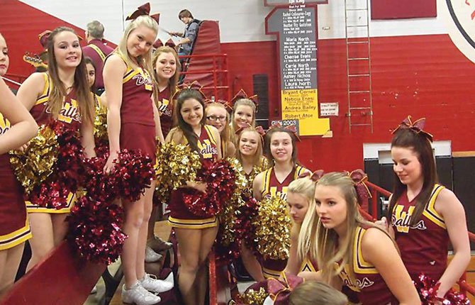 THE DALLES High cheerleaders take time out during halftime at a varsity basketball game last winter at Kurtz Gymnasium. Faced with a name change to start the 2014-15 sports year, the cheer team needs to update its uniforms, equipment and other aspects, but is faced with financial constraints.