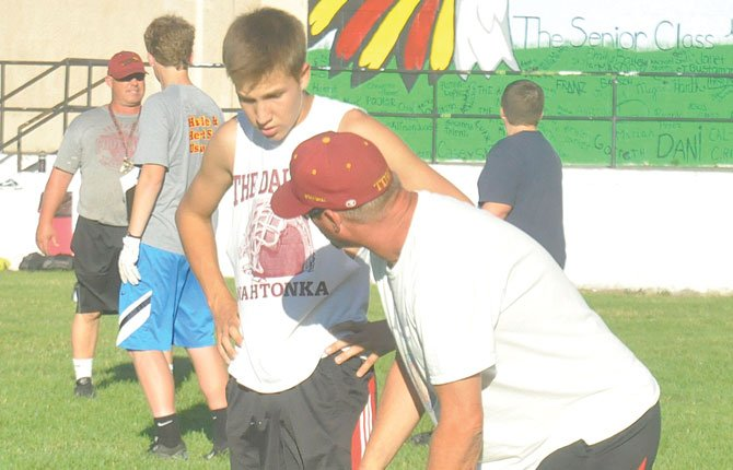 THE DALLES cornerback Ross Kohl (left) gets instructions from defensive coach Rick Wilson during 7-on-7 scrimmages at Amaton Field. Next week, the Riverhawks are at Wahtonka High School for the start of two-a-days.