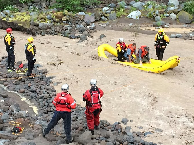 Authorities work on rescuing hikers from the Sandy River in the Mt. Hood National Forest in the midst of a flash flood that occurred Aug. 12 after thunderstorms swept through Oregon. A 34-year-old Illinois man died in the flooding event after he was swept into the river.