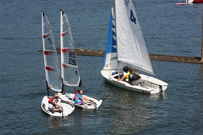 YOUTH sailors head out of Hood River marina for the start of the Commissioner's Cup regatta Sunday. Cole Newbrook, 7, and Stella Waag, 12, are in Bics, Leif Bergstrom, 15, and Erika Anderson, 13, are in the larger 420 boat.