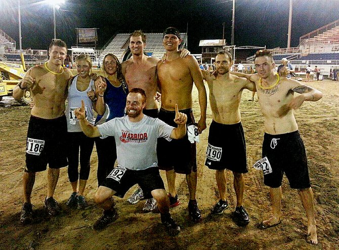 The Draggoo clan celebrates Friday night after members completed the Warrior Stampede obstacle course race.