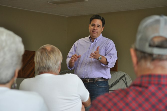 U.S. Representative Raul Labrador (R) answers a constituent's question at last Friday's town hall meeting in Cottonwood.