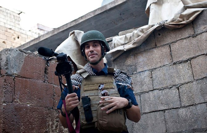 A FILE photo posted in 2012 on the website freejamesfoley.org, shows American journalist James Foley covering the civil war in Aleppo, Syria. In a horrifying act of revenge for U.S. airstrikes in northern Iraq, militants with the Islamic State extremist group have beheaded Foley — and are threatening to kill another hostage, U.S. officials say.