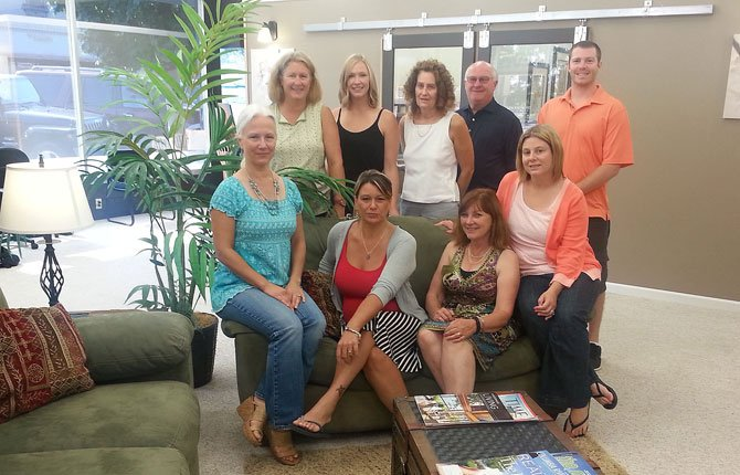 WINDERMERE/GLENN TAYLOR Real Estate brokers gather in the lobby of the company's new The Dalles offices at East Second and Court streets. Pictured, front row from left are Carrie Guthrie, owner Kim Salvesen, Ruby Mason, Healther Wright; back row, Connie Thomasian, Molly Donnell, Vickie Ellett, Mike Woodside and Charlie Foote.