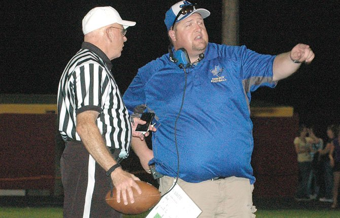 CROOK COUNTY head coach Ryan Cochran (right) discusses a few calls with lead official Bob McFadden at halftime of a non-league football contest in 2013 at Sid White Field in The Dalles.