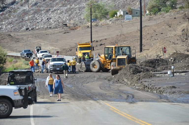 Crews work to clear mudslide on old Highway 97 at the bottom of the Chiliwist road.