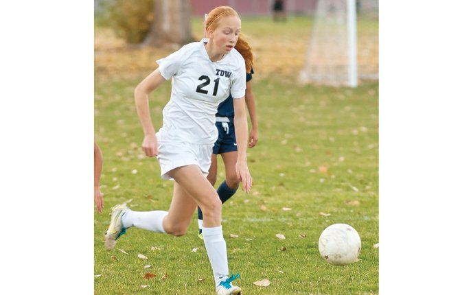 THE DALLES junior Jennifer Bonham hustles past a few players during varsity girl's soccer action last season. With Bonham and a handful of other athletes coming back into the mix, the Riverhawks have a more experienced group in the fold looking to break a two-year playoff drought. 	  			           Mark B. Gibson file photo
