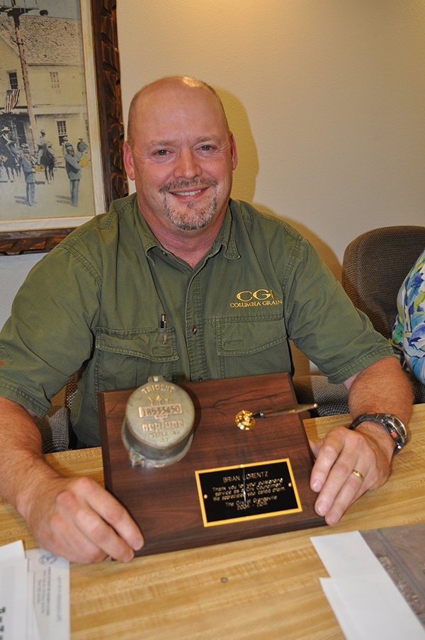 Outgoing Grangeville City Councilor Brian Lorentz was recognized for his service at the regular Aug. 18 meeting with a pen desk set, featuring an antique water meter. Lorentz was appointed to the council in late 2004, was elected to the seat in 2005 and won re-election in 2007 and 2011.